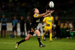 Beauden Barrett tries to catch the ball during a Super Ruby game against the Western Force