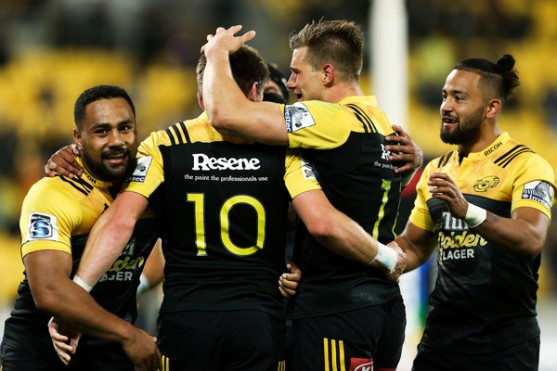 Jason Woodward, Ngani Laumape and Matt Proctor happy for Beauden Barrett who scored a try against Southern Kings