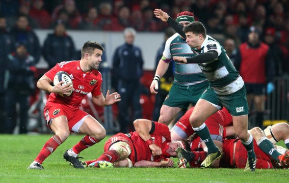 Munster Rugby scrum-half Conor Murray facing his opponent Leicester Tigers' Ben Youngs