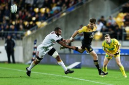 Playmaker Beauden Barrett shows his skills against Michael Leitch and the Chiefs