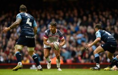 Rhys Webb runs the ball for the Ospreys with the Cardiff Blues defence looking on during Judgement Day