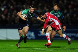 The Ireland and Connacht centre Robbie Henshaw against the Wales and Gloucester fly-half James Hook