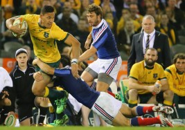 The Wallabies fullback Israel Folau is looking for the offload with Ewen McKenzie watching on