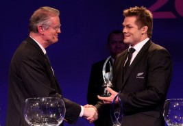 The World Rugby Chairman Bernard Lapasset with the All Blacks legend Richie McCaw