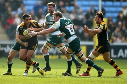 Tom Croft tries to tackle George Smith during an Aviva Premiership meeting involving Leicester Tigers and London Wasps