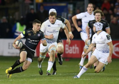 Bath Rugby fly-half George Ford runs the ball with Leinster scrum-half Isaac Boss trying to make a tackle during a Champions Cup game in 2015