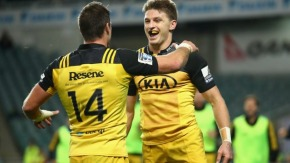Beauden Barrett celebrates his try with winger Cory Jane against the Waratahs in Super Rugby 2016