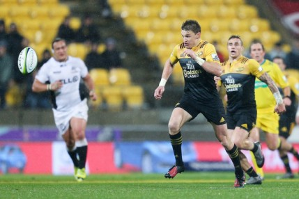 The Hurricanes playmaker Beauden Barrett chases the ball under the storm at Westpac Stadium during the Super Rugby Quarter-finals