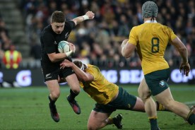 Beauden Barrett against Australia with Michael Hooper making the tackle and David Pocock watching on during the 2016 Rugby Championship game