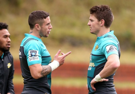 The Hurricanes half-backs TJ Perenara and Beauden Barrett have a talk during a training session before the 2016 Super Rugby final