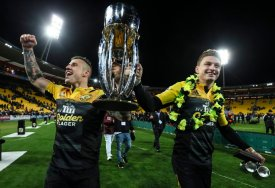 The Hurricanes players TJ Perenara and Beauden Barrett holds the 2016 Super Rugby Trophy at Westpac Stadium, Wellington