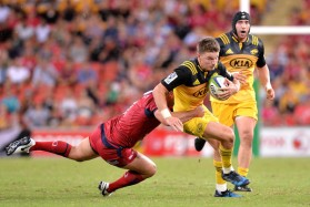 The Hurricanes first-five eighth Beauden Barrett tackled by a Queensland Reds player during the Round 6 of Super Rugby 2017 in Brisbane