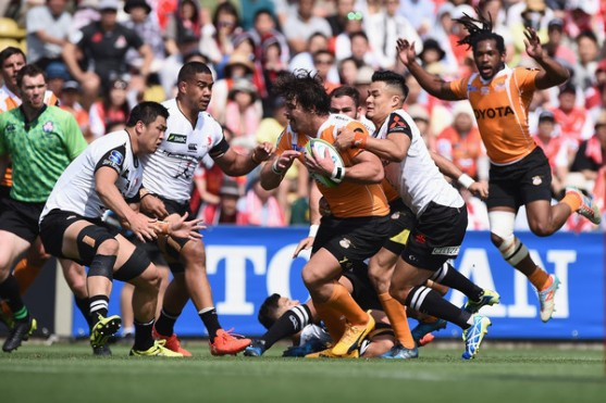 The Cheetahs centre Clinton Swart is tackled by the Sunwolves defence during a Super Rugby game in Tokyo, in 2017
