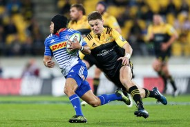 The Hurricanes playmaker Beauden Barrett is trying to tackle the Stormers winger Cheslin Kolbe at Westpac Stadium in Wellington in 2017