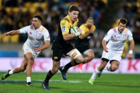 Beauden Barrett is running the ball for the Hurricanes against the Chiefs at Westpac Stadium, Wellington, during the Super Rugby 2017
