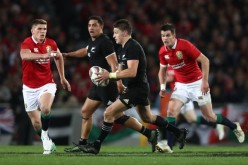 The New Zealand first-five eighth Beauden Barrett is running the ball during the British & Irish Lions series at Eden Park, Auckland, in 2017
