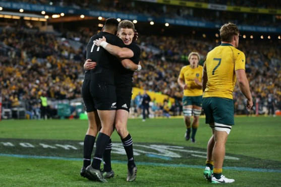 Beauden Barrett celebrates a try with Rieko Ioane during the Rugby Championship opening game between Australia and New Zealand in 2017