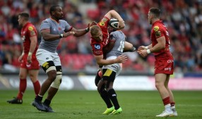 Winger Johnny McNicholl is tackled during the Scarlets' opening Pro14 game against the Southern Kings in Llanelli during the 2017-2018 season