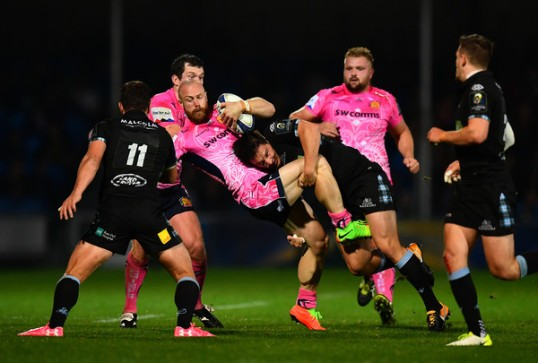 The Exeter Chiefs winger James Short is tackled by the Glasgow Warriors defence during the Champions Cup 2017-2018 at Sandy Park