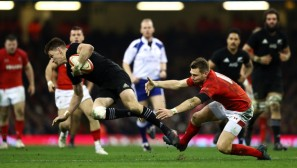 The All Blacks first-five eighth Beauden Barrett is tackled by the Wales fly-haf Dan Biggar during the 2017 November Internationals in Cardiff