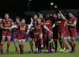 The Harlequins players are celebrating their Anglo-Welsh Cup win against the Saracens during the 2016-2017 season at Allianz Park, London