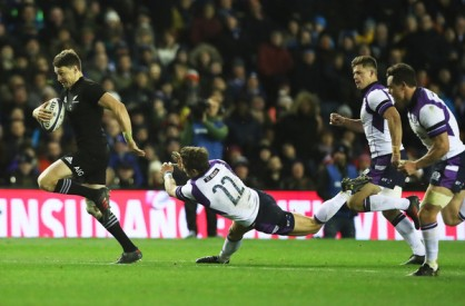 The New Zealand first five-eighth Beauden Barrett on his way to score his 24th Test try against Scotland during the Autumn campaign in 2017