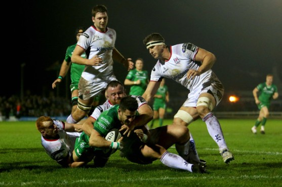 The Connacht fullback Tiernan O'Halloran dives to score a try against Ulster during the 2017-2018 Pro14 season