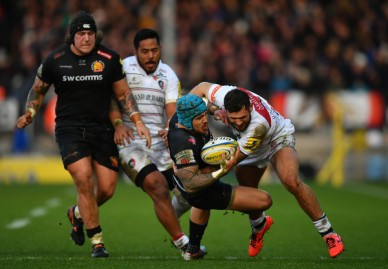 The Exeter Chiefs winger Jack Nowell is tackled by the Leicester Tigers winger Adam Thompstone in the Premiership during the 2017-2018 season
