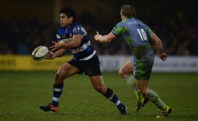 The Bath Rugby centre Ben Tapuai is running the ball against the Newcastle Warriors' Joel Hodgson in the 2017-2018 Anglo-Welsh Cup