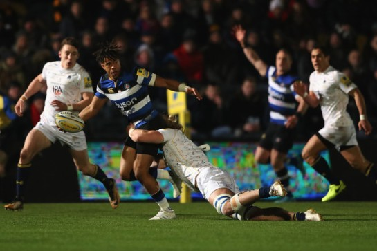 The Bath Rugby fullback Anthony Watson is trying to offload against the Worcester Warriors at Sixways during the 2017-2018 Premiership season