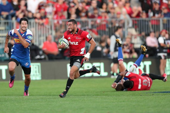 The Crusaders scrum-half Bryn Hall on his way to score a try against the Stormers in Super Rugby, in 2018, in Christchurch, New Zealand