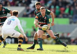 The Leicester Tigers fly-half George Ford is passing the ball against the Wasps during the 2017-2018 Premiership season, in Welford Road