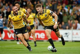 The Hurricanes first-five eighth Beauden Barrett celebrates his try with TJ Perenara against the Melbourne Rebels during the Super Rugby 2018