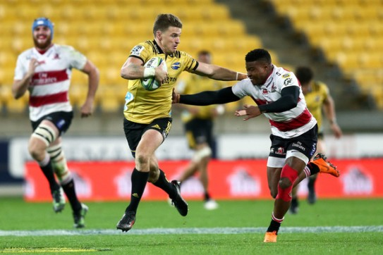 The All Blacks first-five eighth Beauden Barrett running the ball for the Hurricanes against the Lions in Wellington during Super Rugby 2018