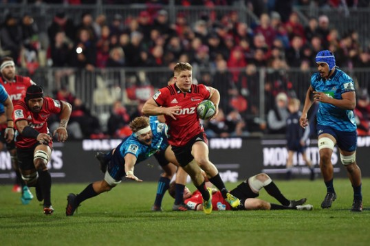 The All Blacks centre Jack Goodhue runs the ball for the Crusaders against the Blues during the Super Rugby game in Christchurch, in 2018