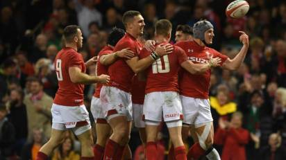 The Wales centre Jonathan Davies is celebrating after scoring a try against Scotland during the 2018 Autumn Tour in Principality Stadium