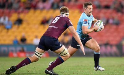 The Waratahs playmaker Bernard Foley trying to find a way in the Queensland Reds defence during the 2019 Super Rugby fixture win in Brisbane