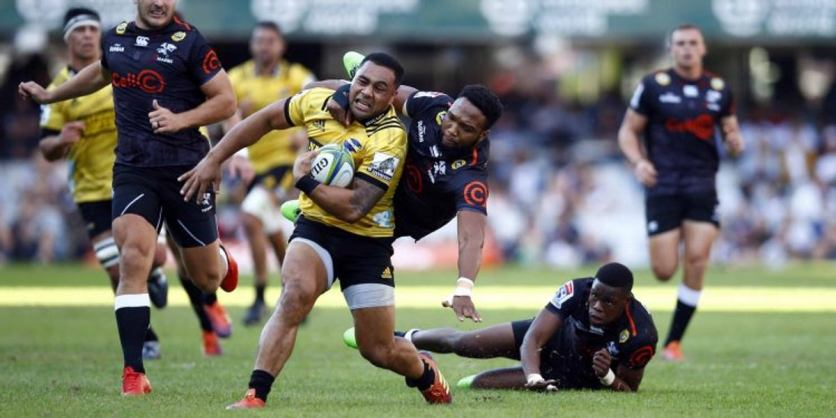 The Hurricanes centre Ngani Laumape is high-tackled by the Sharks centre Lukhanyo Am during the 2019 Super Rugby fixture in South Africa
