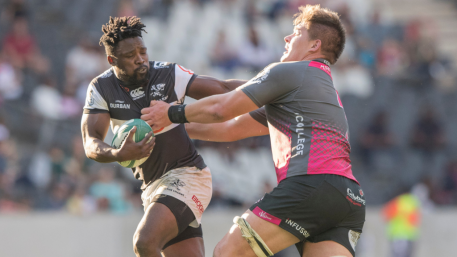 The Durban Sharks winger Lwazi Mvovo against the Pumas defence during the Currie Cup in 2019
