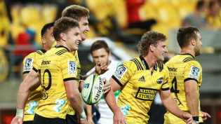 The Hurricanes players celebrating a try against the Stormers at Westpac Stadium in the 2019 Super Rugby