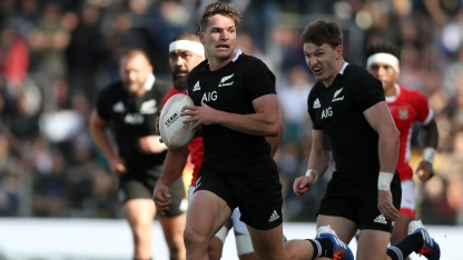 Beauden Barrett running in support of George Bridge during the 2019 World Cup warm-up game between New Zealand and Tonga, in Hamilton
